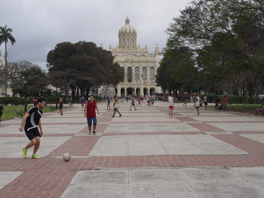 In any open space without cars you'll find a soccer game happening... don't worry they'll just play around you. Capital building of Cuba in the background.