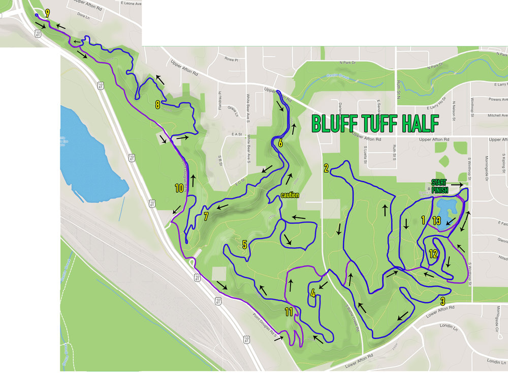 "Half Marathon Course, the blue line indicates the ""out"" route to the far point on course. The purple shows the ""return"" route from the far point. See the following map for more detail."