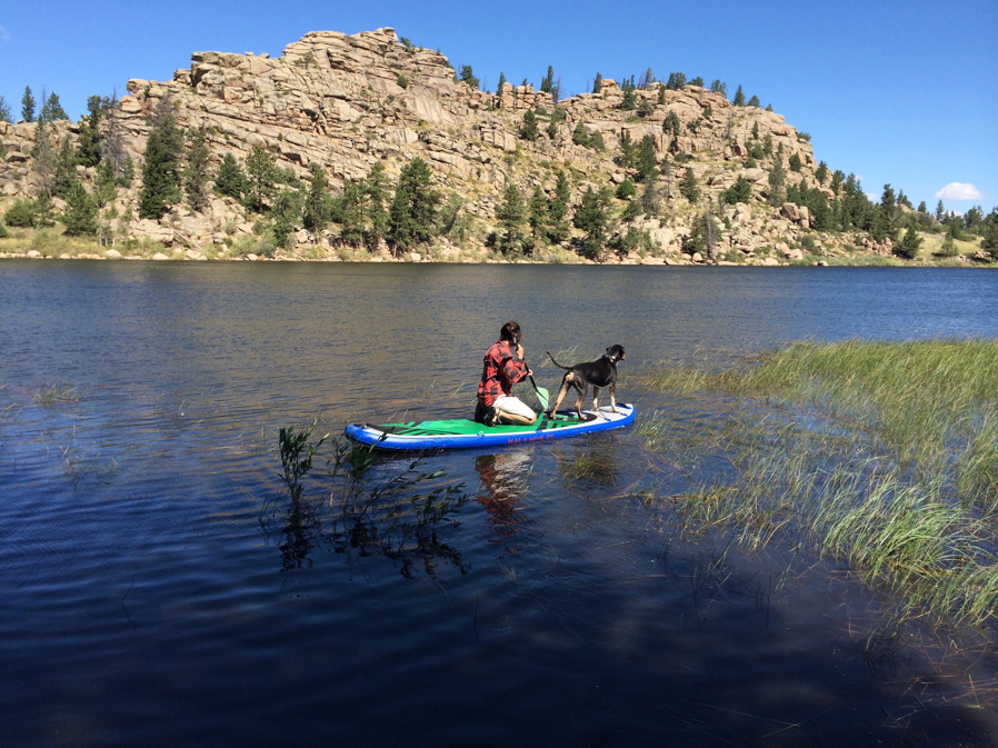Charissa and Dylon near Red Feather Lakes paddle boarding and looking for Ducks.