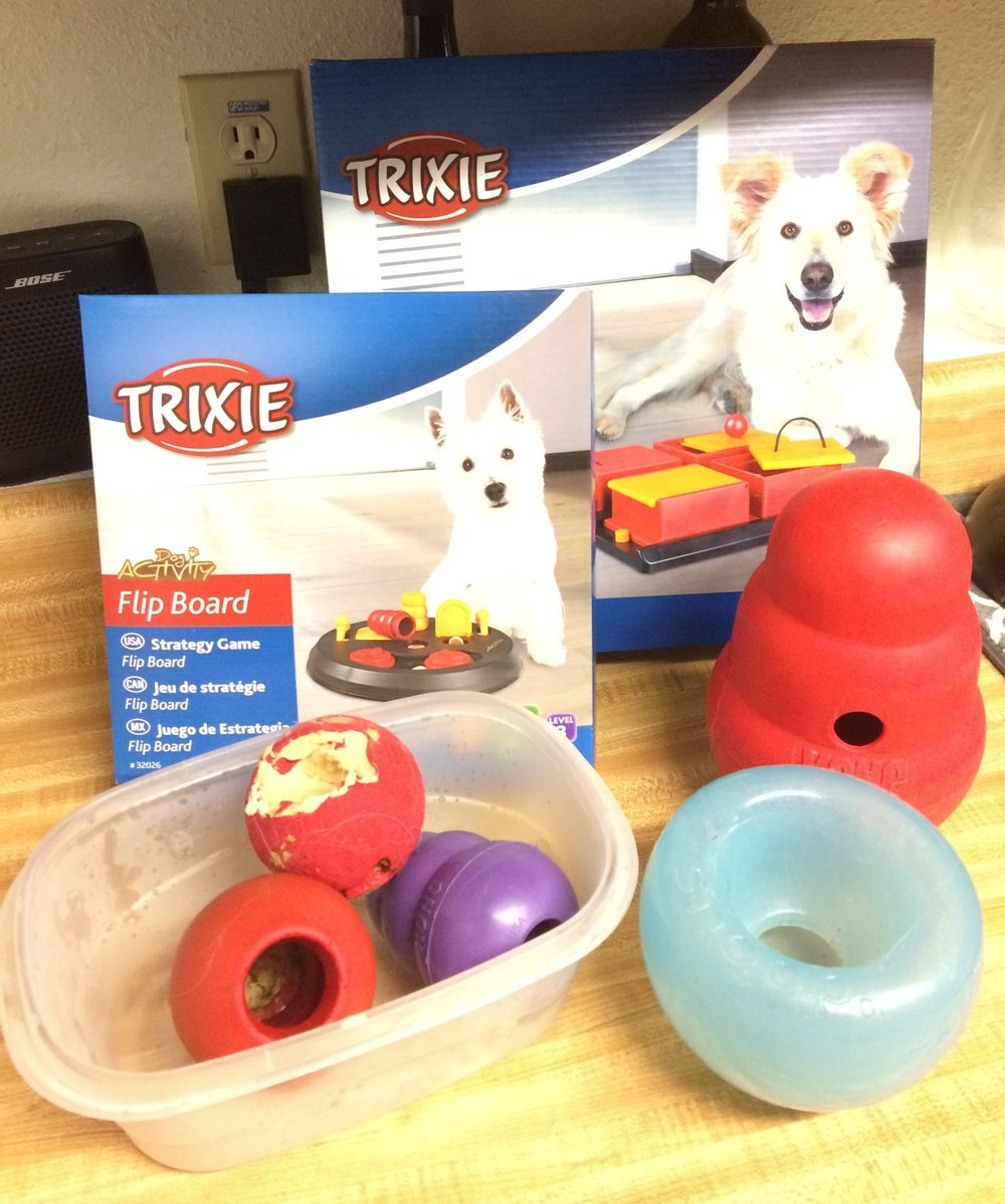 A few of my pup's favorite types of food puzzles! Kong Classics, Kong Wobbler, Orbee Snoop, and Trixie Puzzle Boxes.