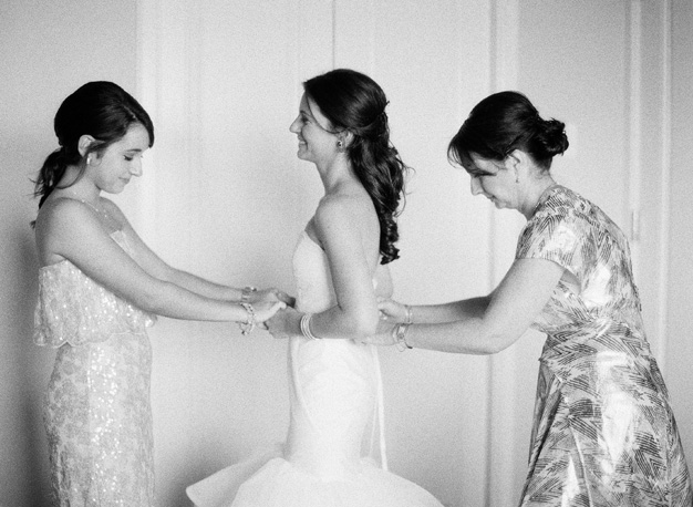 Bride getting ready at Miami wedding - Photo by Kat Braman