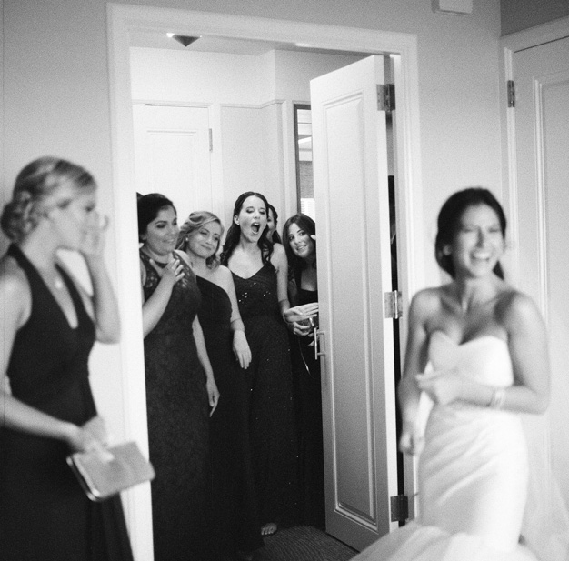 First look with bridesmaids at Miami wedding - Photo by Kat Braman