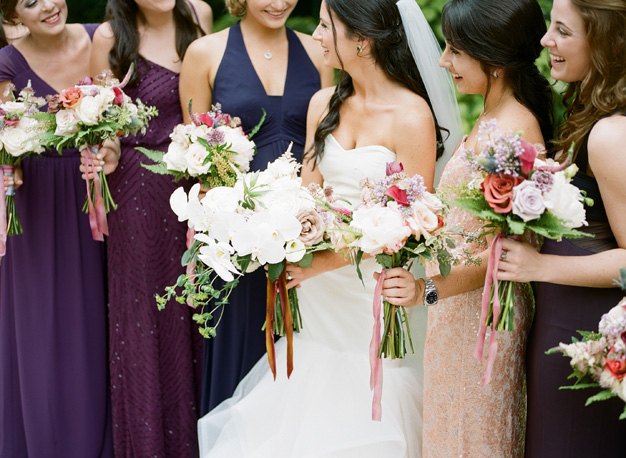 Shades of purple bridesmaids at Miami wedding - photo by Kat Braman