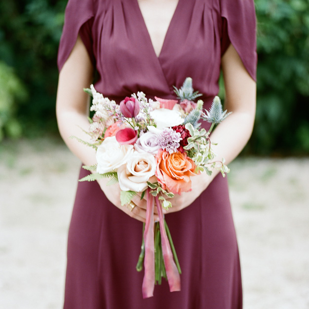 Purple bridesmaid dress with bouquet at Miami wedding - photo by Kat Braman
