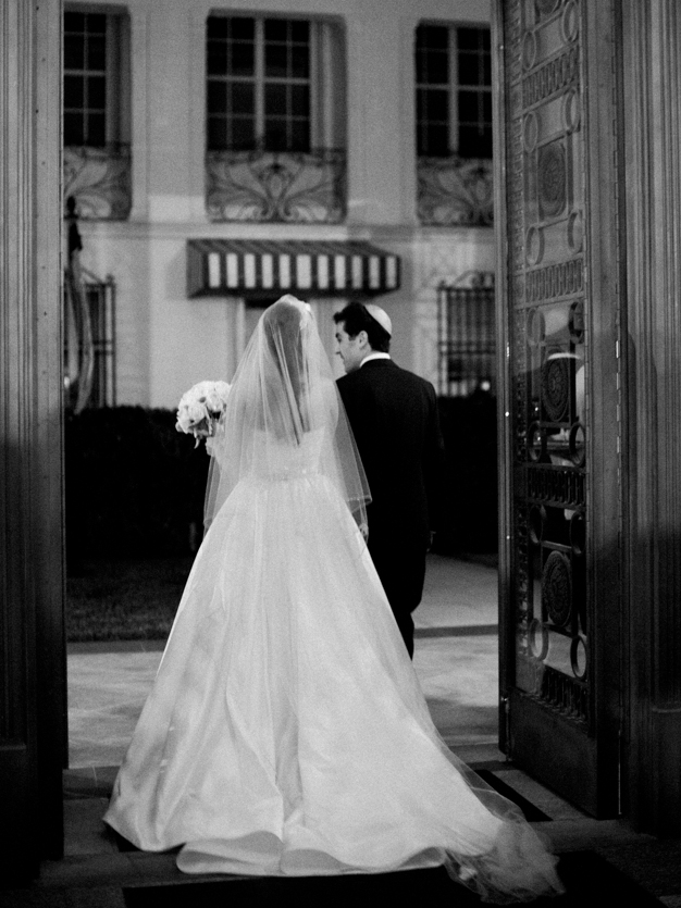 Bride and Groom Exit at Flagler Museum Wedding in Palm Beach - photo by Kat Braman