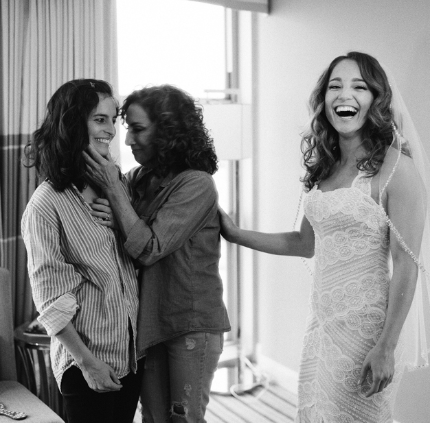 Bride Getting Ready in WTOO Dress with mom and sister - Photo by Kat Braman