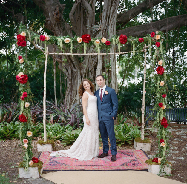 Bride and Groom under Floral Chuppah at Miami Beach Botanical Gardens - photo by Kat Braman