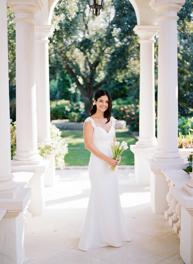 Bride in lace wedding dress with white tulip bouquet in Palm Beach garden wedding - photo by Kat Braman