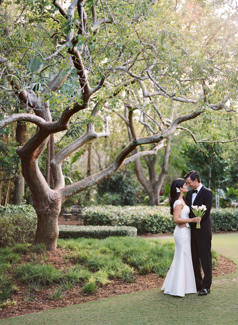Bride and Groom stealing a private moment at their Palm Beach garden wedding - photo by Kat Braman