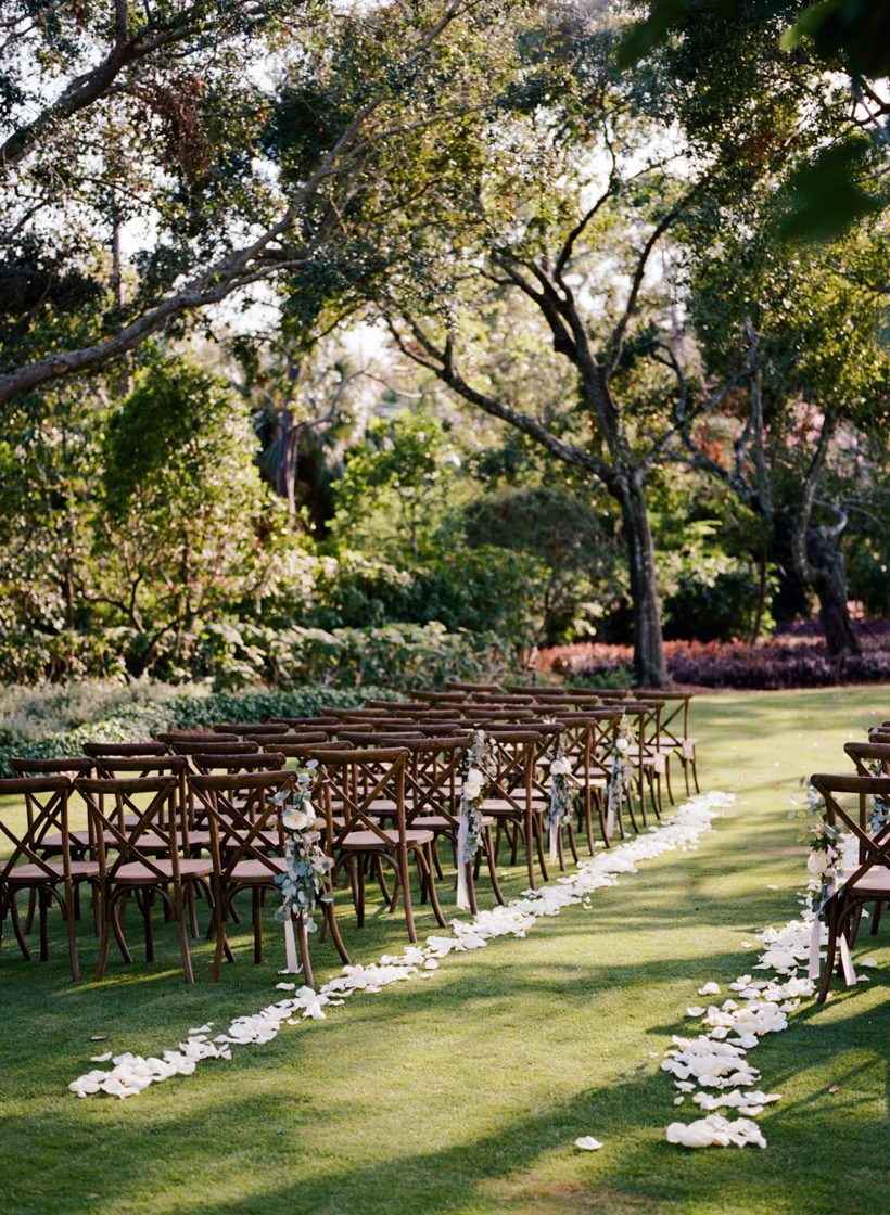 Simple ceremony design created by Desiree Dawn Events and Port and Palm Co. to enhance the beautiful garden setting rather than compete with it.  Photo by Kat Braman