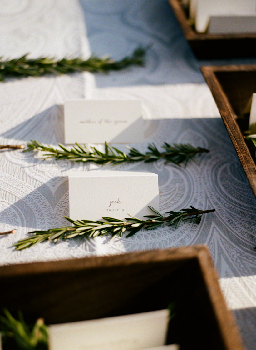 Letterpress escort cards from Able Letterpress were accented with sprigs of rosemary and beautiful linens from Sophisticated Settings.  Photo by Kat Braman