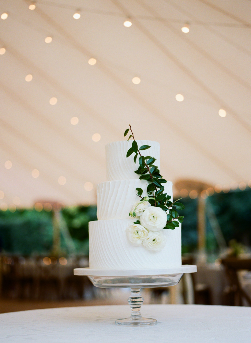 Wedding Cake from Earth and Sugar accented by ranunculus and greenery.  Photo by Kat Braman.