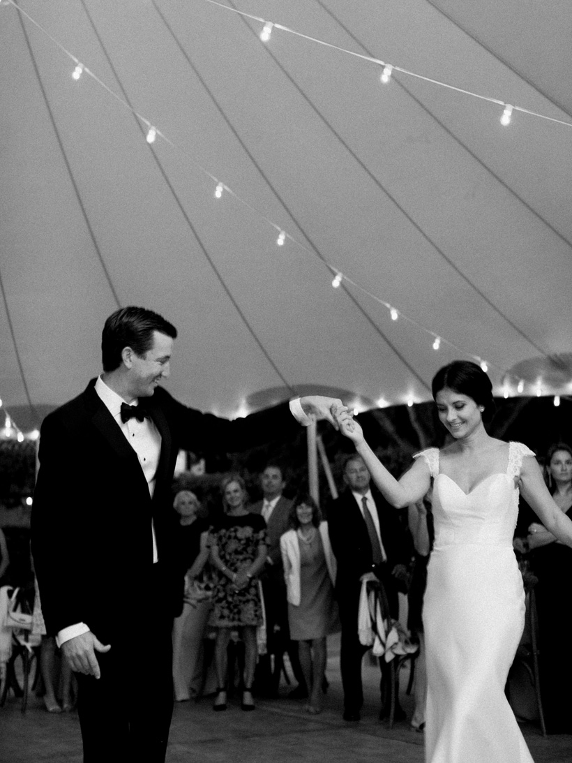 First Dance with Sperry Tent and bistro light backdrop - photo by Kat Braman