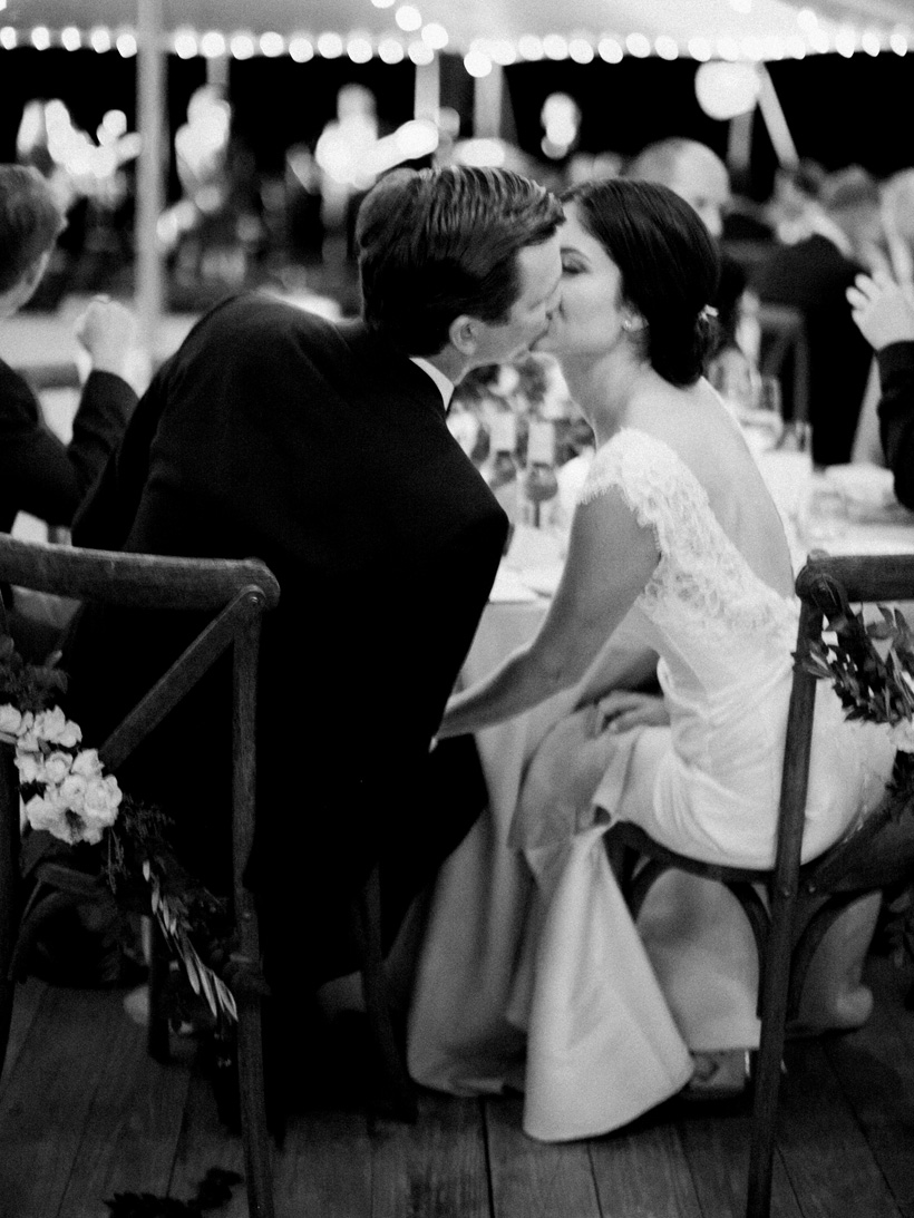 Bride and groom share an intimate moment during their wedding reception.  Photo by Kat Braman