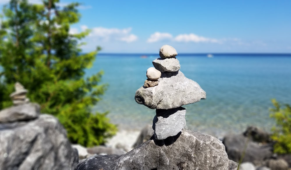 Among the sea of natural beauty that is Mackinac Island, visitors had taken it upon themselves to construct rickety rock towers all along the eastern shoreline.