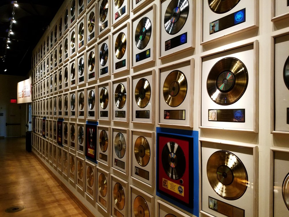 Records upon records line a wall of the Country Music Hall of Fame and Museum
