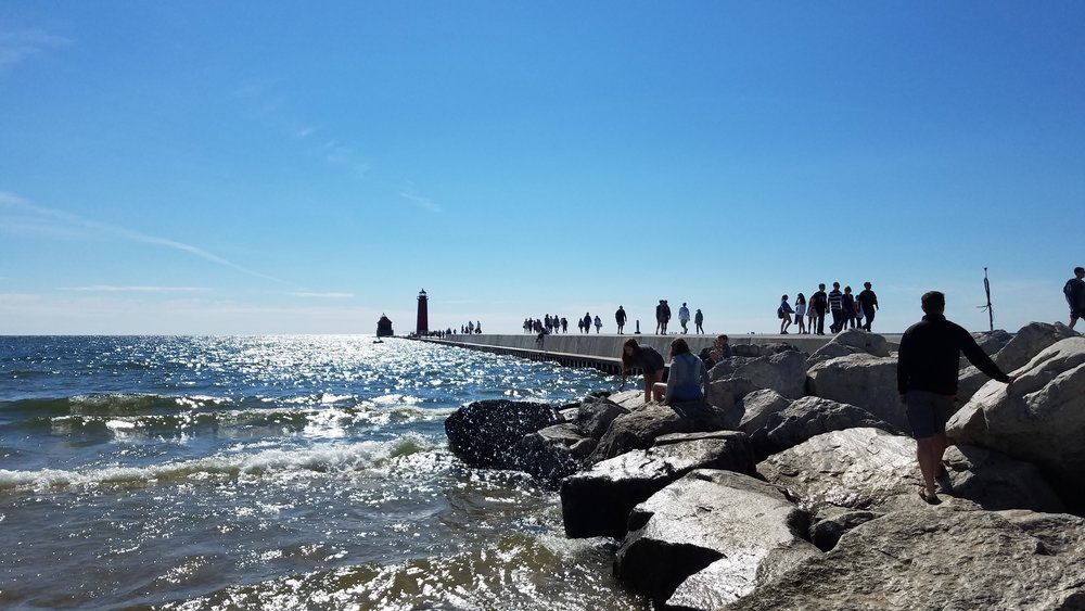 Grand Haven's iconic pier stretches out into Lake Michigan on a sunny Saturday afternoon