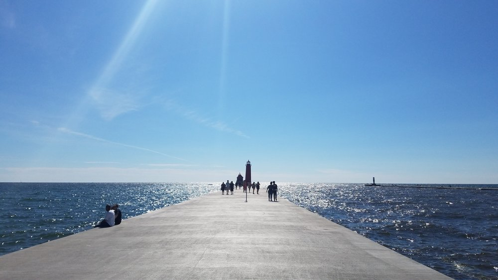 The pier at Grand Haven State Park is  undergoing some renovations  right now, which is why the catwalk is noticeably absent from this photo. I don't think it takes anything away from the beauty of the scene, but don't take my word for it — get out there and see for yourself.