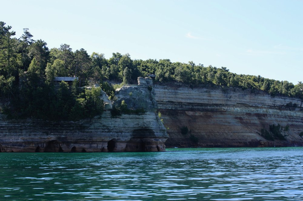 "It would be difficult to decipher which of Pictured Rocks' features is most famous, but there is only one that has been used as the site of a wedding ceremony — and that would be  Miners Castle . Receiving its name from Englishmen in search of minerals in 1771, the Castle has towered along the shoreline for centuries and even served as a major inspiration for Henry Wadsworth Longfellow's 1855 poem "" The Song of Hiawatha ""."
