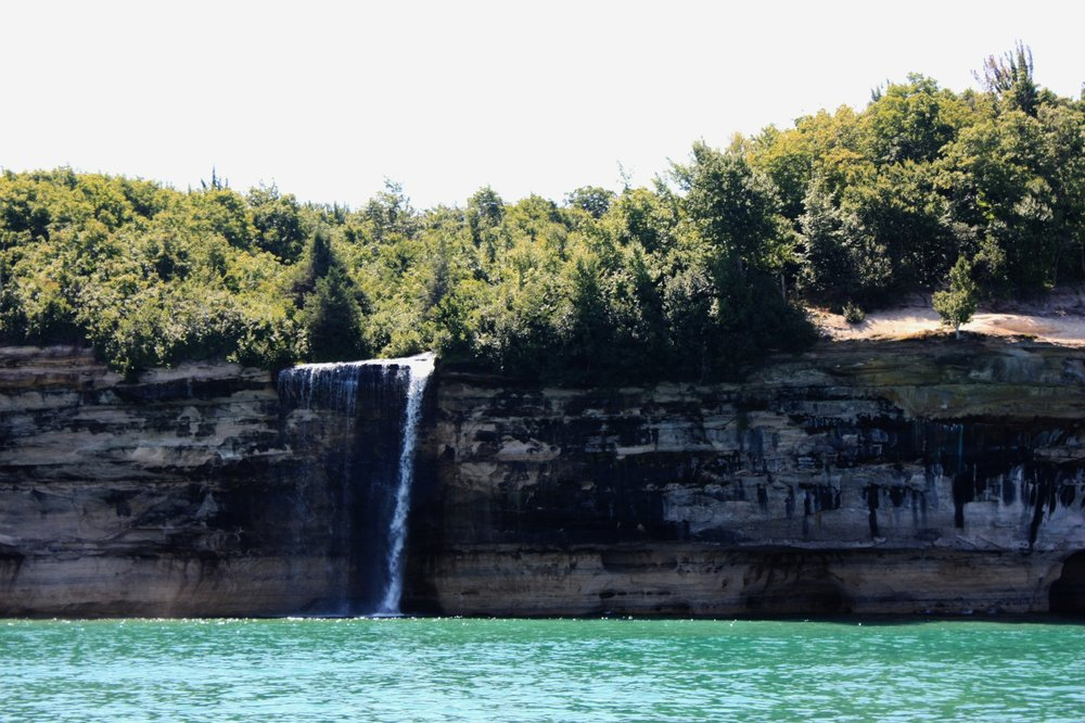 "There are  a few waterfalls  along Pictured Rocks National Lakeshore that constantly quench Lake Superior's thirst, including this little fella, Spray Falls, which is best viewed by boat. Fun fact: the remains of a ship named ""Superior,"" which sank in 1856, lie at the base of Spray Falls in about 20 feet of water."