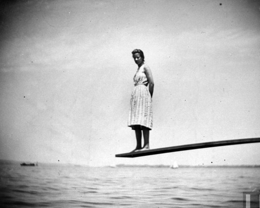 Maggie Ward standing on the end of a diving board at Coney Island, Brooklyn, July 24, 1888