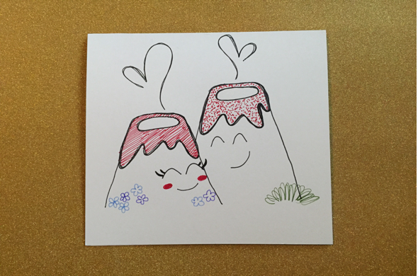 Now draw a mouth! And also with your colored pens or markers, add some detail. I added flowers, grass and rose-colored cheeks.