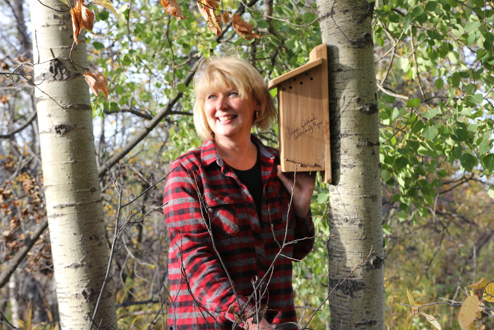 Mayor of Leduc County with the nest box she installed at Coates Conservation Lands