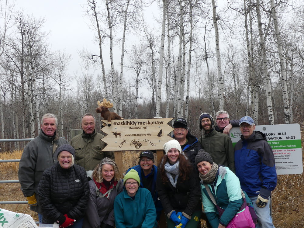 Volunteers installed a sign bearing the Cree name of Glory Hills