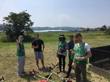 RP Team after cutting a field: Laura T, Ben, Melannie, neighbor, Rebekah, Seth