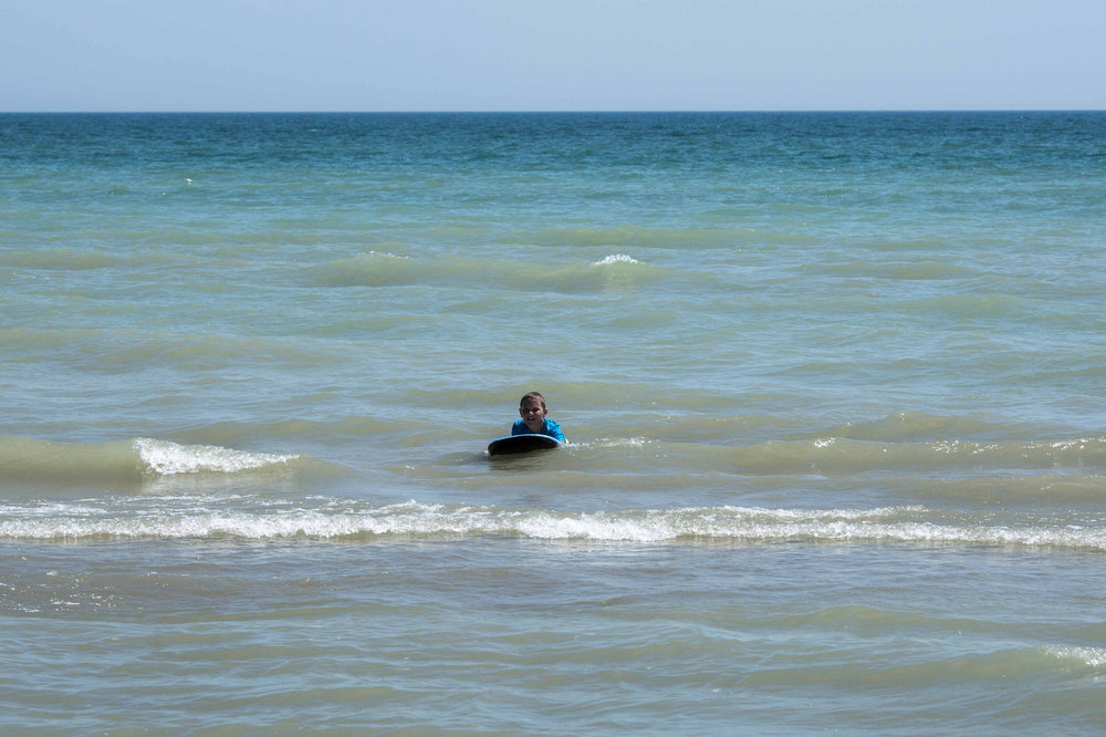 Daniel on his boogie board, Long Point Provincial Park, Ontario, Canada - Photo by Todd Sechel