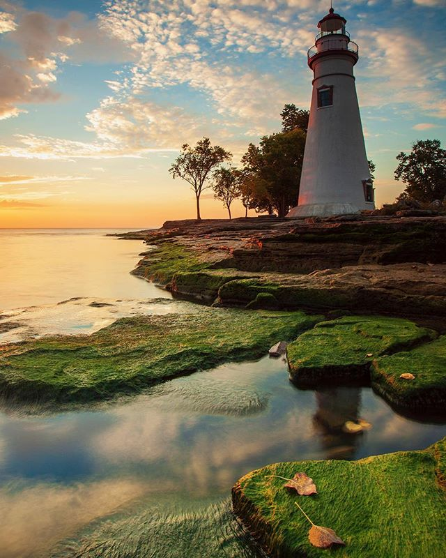 A little bit of color to start the week off right. We are still waiting on the best of the fall colors here in NE Ohio, so here is one from a few years back when Lake Erie was much lower! Have a wonderful start to your day!  Prints available at: toddsechel.com  Fall Sunrise - Marblehead Light - Marblehead, Ohio