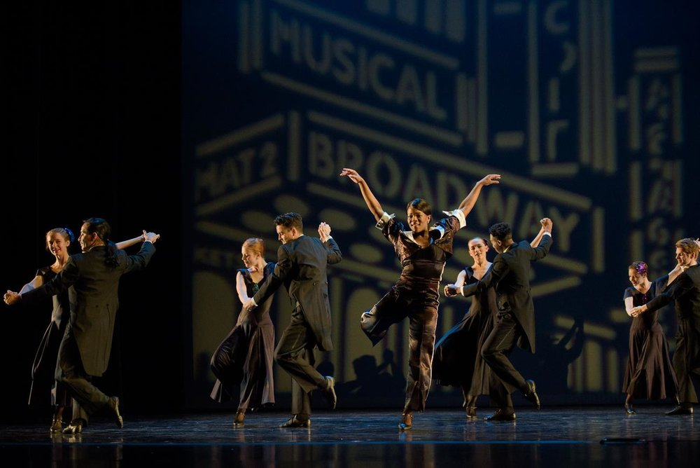 "Ursula Perry (center) and members of Repertory Dance Theatre in Bill Evans' ""Suite Benny."" Photo by Sharon Kain."
