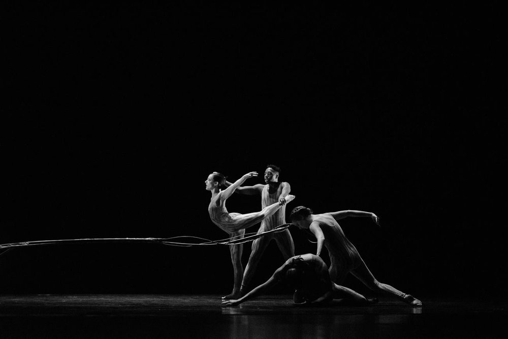 "Lauren Curley (left), Justin Bass, and members of Repertory Dance Theatre in Evans' ""Tintal."" Photo by Sharon Kain."