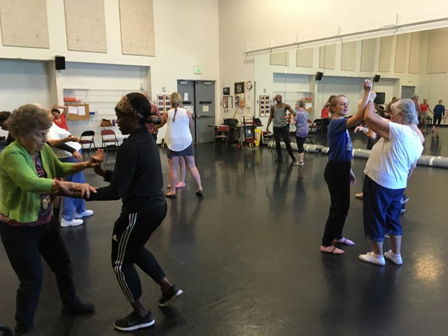 In the foreground, Adams' mother dancing with RDT dancer Ursula Perry in an improvisation workshop for aging populations in 2016 lead by St. Louis-based RDT alum David Marchant. (Marchant's workshop was separate from Claudio's work referenced below.)