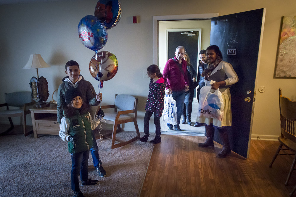 A refugee family is welcomed into their new apartment by staff and volunteers from World Relief's Nashville office. (Photo courtesy Sean Sheridan)