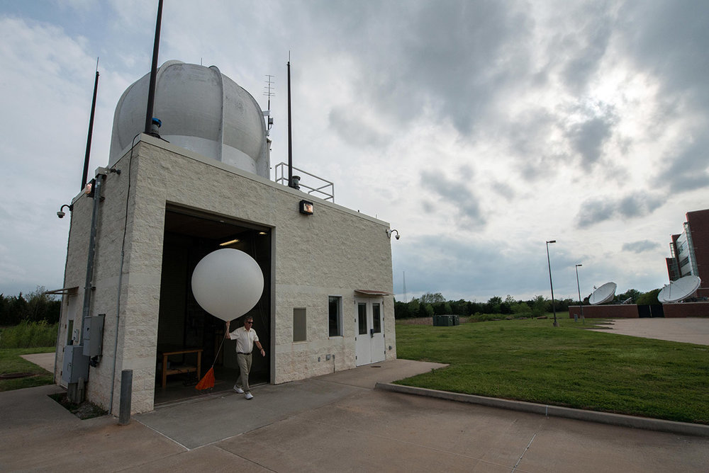 A Glimpse into the Atmosphere – Balloons Still at the Forefront of Forecasting - Medill Reports, 5 June 2018Norman, OK: Just around the corner from the National Weather Center in Norman, Oklahoma, a small cylinder-block building with antennas and a sphere on the roof marks the site of crucial weather data collection.