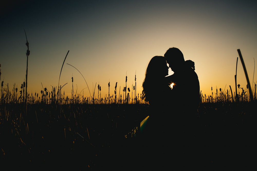 ^ I'm a total sucker for silhouettes, and this is one of my favourites that I've ever shot.  I love the tones of the sky, the little hint of the sun popping between them, the reeds, the love in Jimmy & Esther's pose.  Just perfect!
