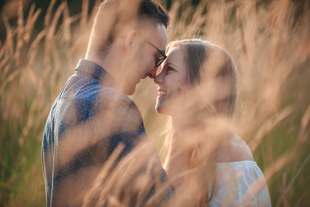 "^ ""The moments between."" I love this smiling shot of Halyna and Jason during their engagement session because it's so natural.  When we work with couples, it's often their first time with a professional photographer.  They almost always ask us, ""You're going to tell us how to pose, right?""  One of my favourite things as a photographer is capturing that moment right after they break from a ""pose"" or a kiss, and have a connection, a laugh, or even just a glimpse at each other."