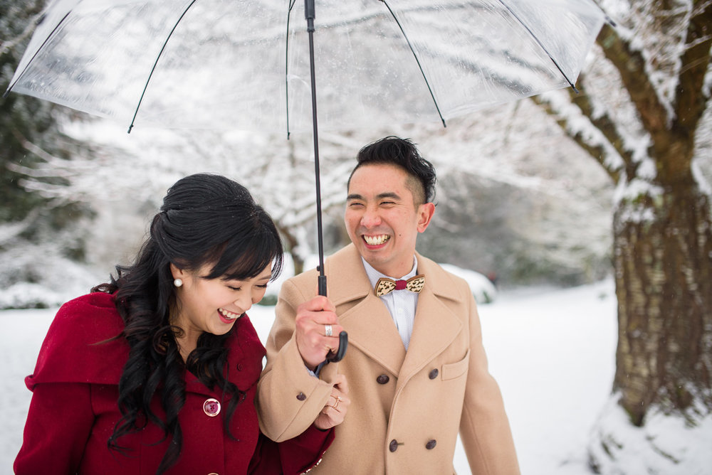 couple laughing in the snow at their wedding at at minoru chapel in richmond bc - victoria wedding photographers