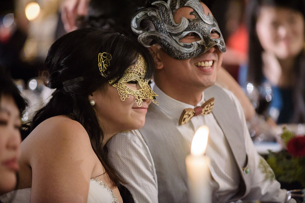wedding couple smiling at masquerade wedding at ubc boathouse in richmond bc - victoria wedding photographer