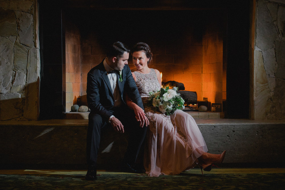 bride and groom portrait in front of the fireplace at Westwood Plateau - Vancouver Island Wedding Photographers