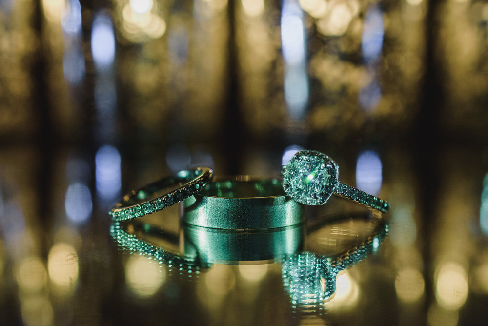 creative lighting picture of wedding rings at the Pear Tree Restaurant in Burnaby BC - Vancouver Island Wedding Photographer
