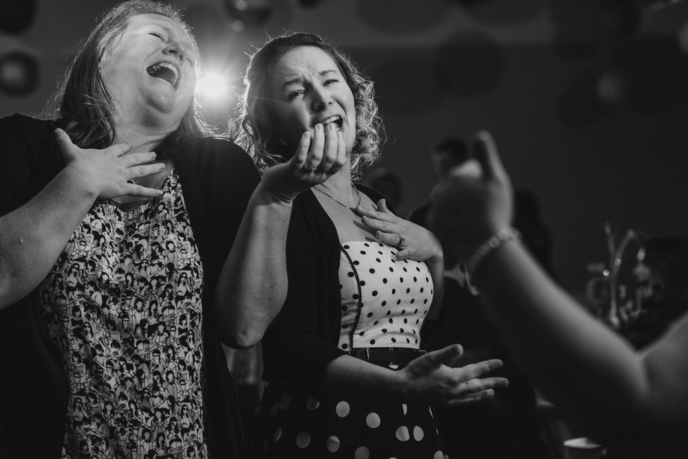 women singing on the dance floor at Whonnock Lake Centre in Maple Ridge - Victoria Wedding Photographers