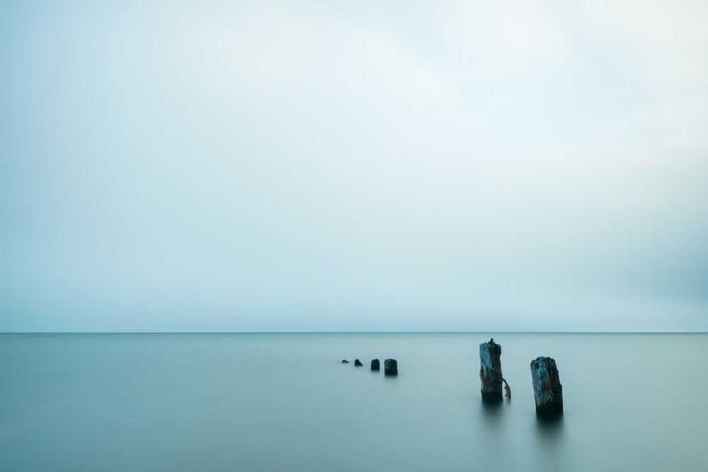 "After the fog came in we left Sheringham Point and headed to Jordan River where we photographed this row of pilings.  The fog on the horizon actually made for a great backdrop, creating an ""infinity"" effect where typically you can see the Olympic Peninsula in Washington."