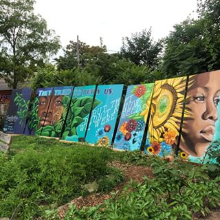 """""""They tried to bury us, but they didn't know we were seeds"""". Painted with Summer youth employment program. (Panels before being installed on Billboard) 35 x 8ft."""