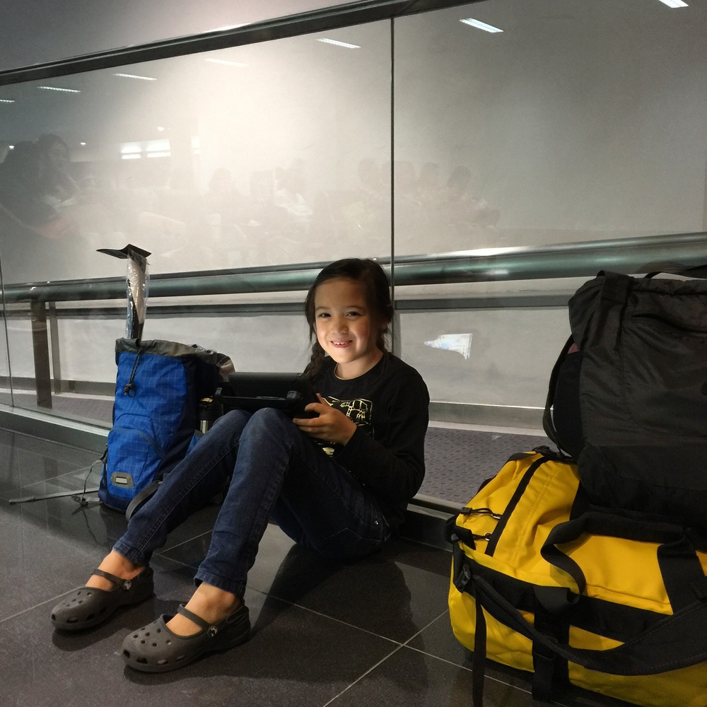 Anna, waiting for our 10 PM flight to return to Taiwan after our whirlwind trip to the Philippines. That bright yellow monstrosity/duffel bag is the aforementioned North Face duffel.