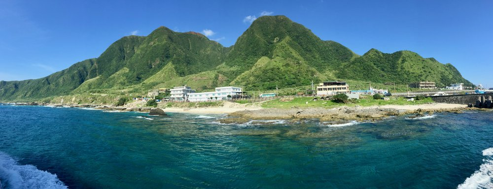 A panoramic shot of Orchid Island from the outgoing ferry.