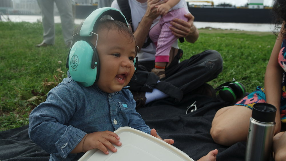 My son accompanies Jason Moran on the Tupperware drum as we picnic with friends.