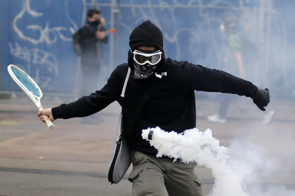 Protestor with tennis racket