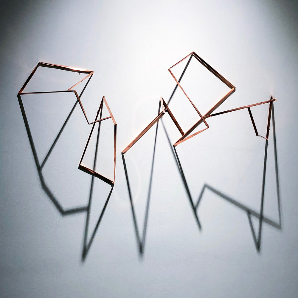 "Standard Unstoppages II , 2018 - 2 x wall mounted 50"" copper extrusions."